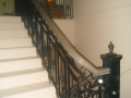 Wood Stair railings with decorative metal inlays Vancouver